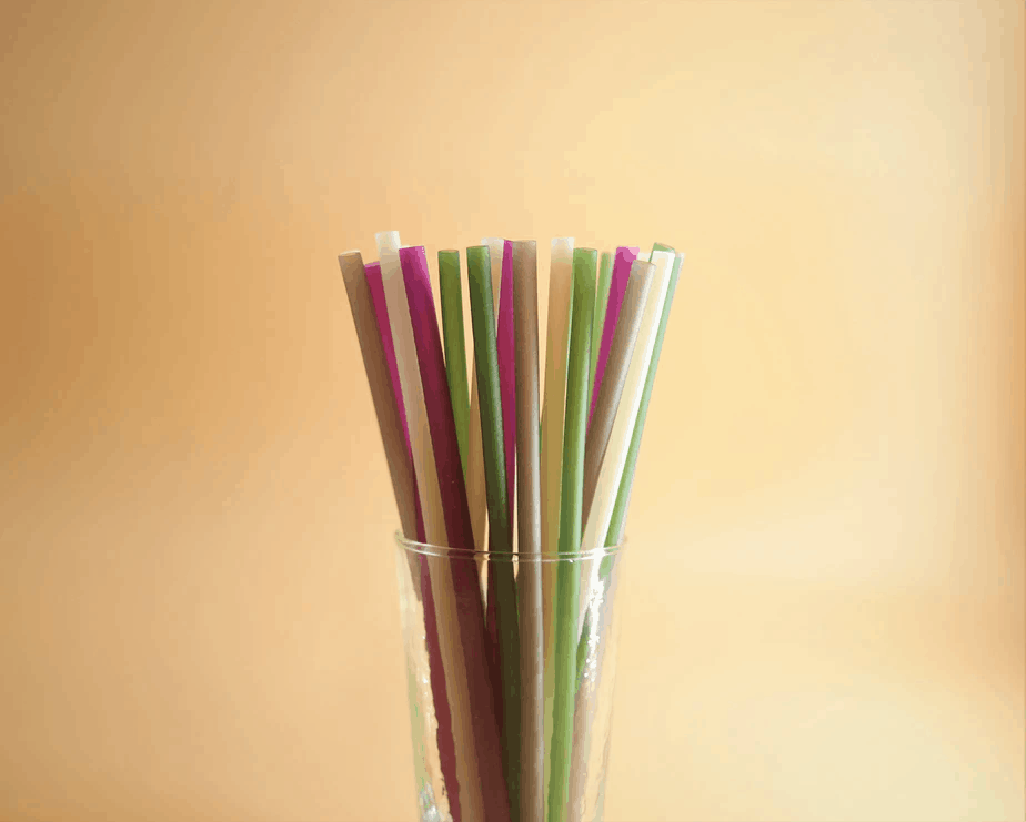 An assortment of straws in a plastic cup