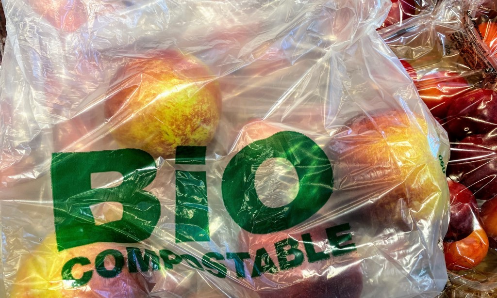 A bio compostable bag filled with apples